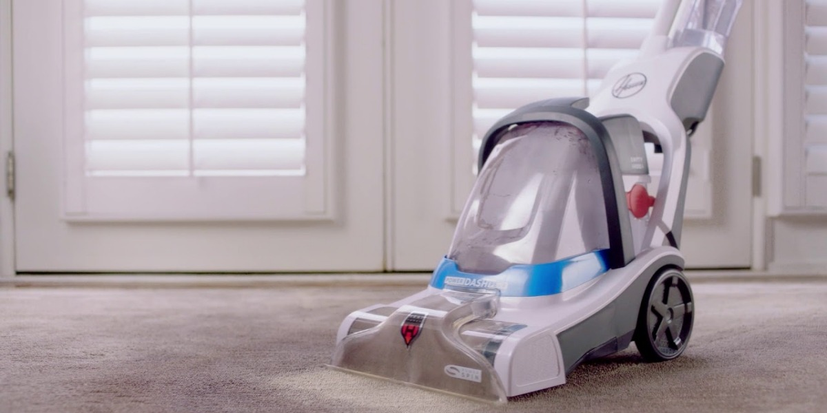 Closer look of Hoover PowerDash Pet Compact FH50700 carpet cleaner machine removing dust from the floor