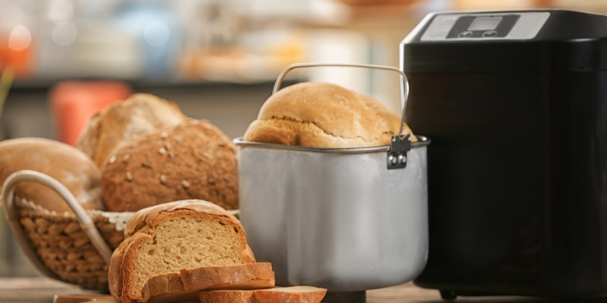 A bread maker with a lot of bread around it