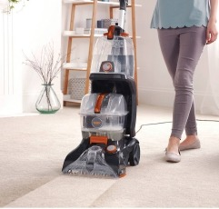 Vax Rapid Power Revive Carpet Washer carpet cleaner machine being used by a woman
