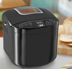 Russell Hobbs 23620 bread maker next to some bread
