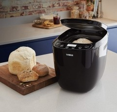 Tower T11003 bread maker next to some loafs