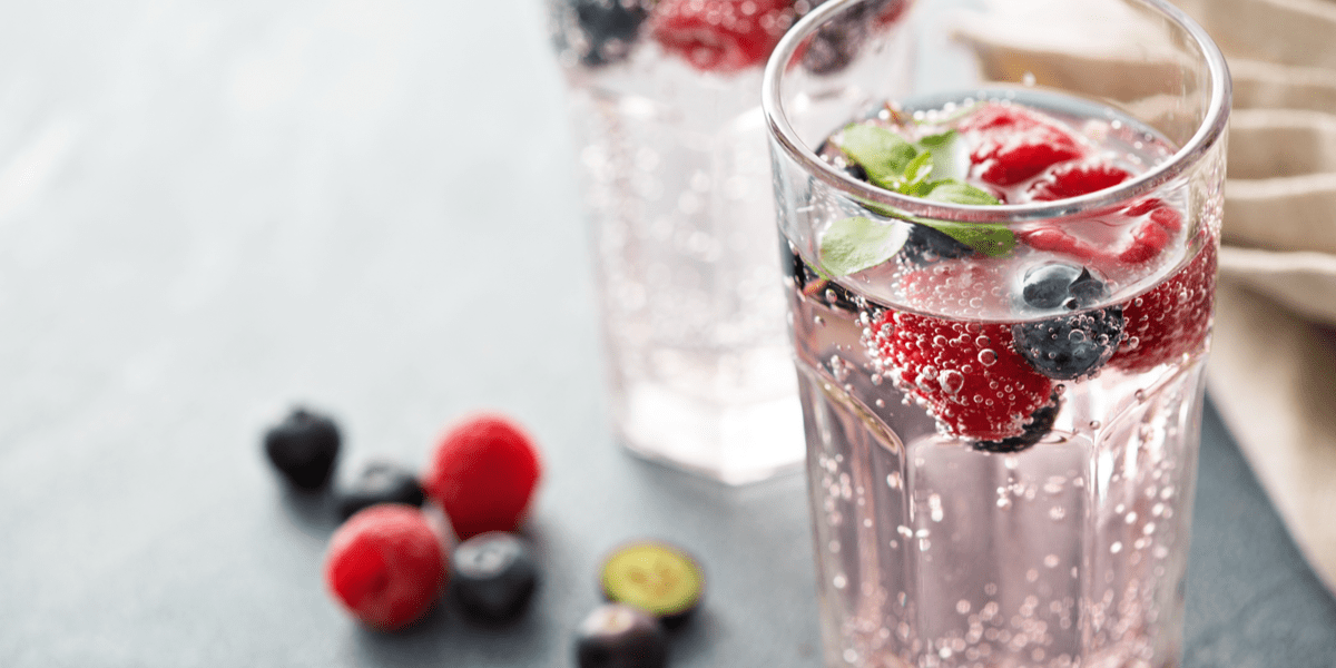 sparkling berry water on counter-top