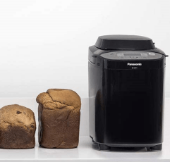 Panasonic SD-2511KXC bread maker next to some loaves