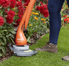 Woman trimming grass with Flymo Contour 500E Electric Grass Trimmer