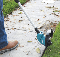 Man trimming grass with Makita 18V Body Only Cordless Li-ion Line Trimmer