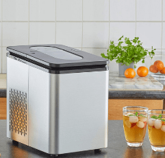 Neo Store Automatic Electric Ice Cube Maker with two glasses filled with ice cubes on a countertop