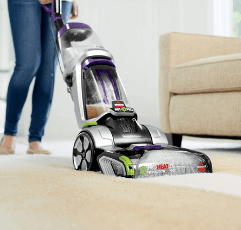 woman cleaning her carpet with the BISSELL ProHeat 2X Revolution Pet Pro