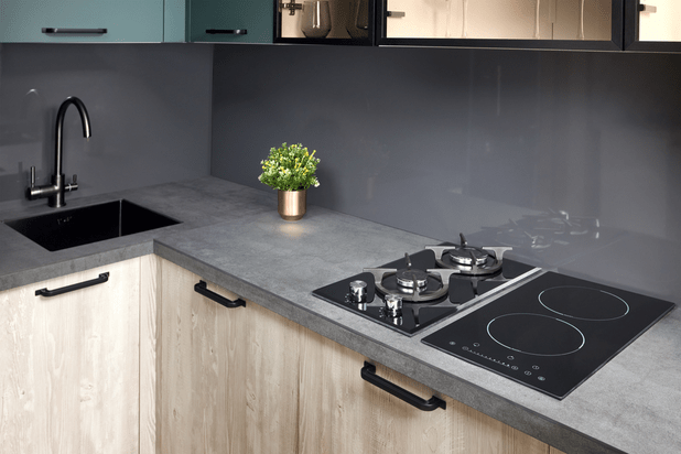 A modern kitchen in luxury home with induction electric hob