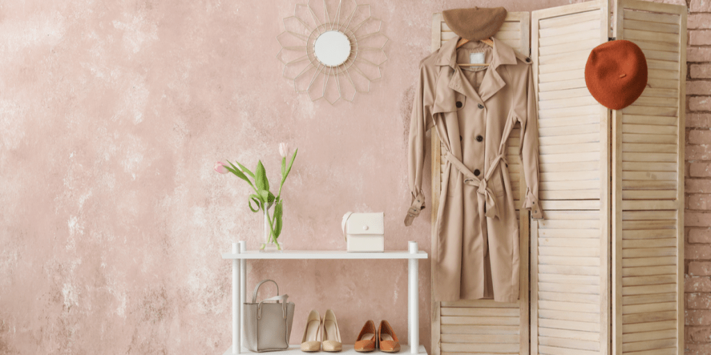 A stylish hallway with a folding screen and a shoe rack.