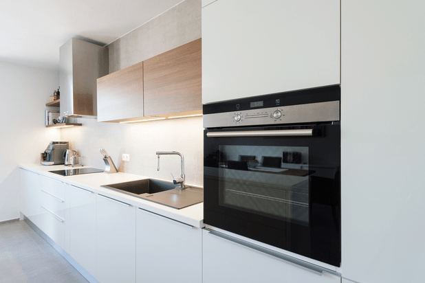 Modern kitchen interior with with built-in oven