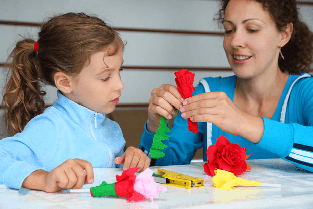 Mother and daughter making paper flowers