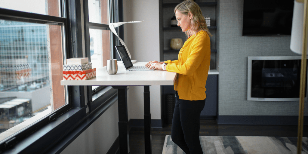woman focused on work using one of the best standing desks