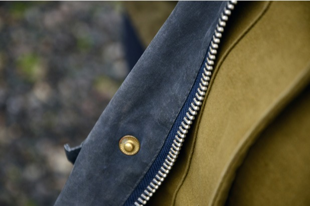 A close up of the zip on a Barbour jacket