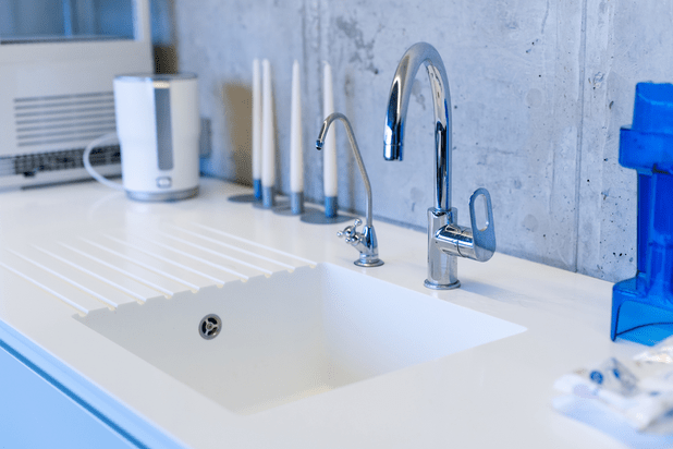 A tidy sink with a tap and a filter one