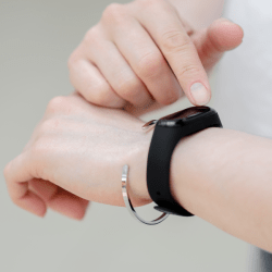 Fitness bracelet on abstract background