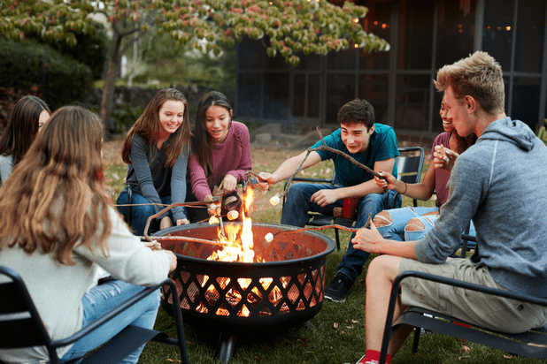Group of friends around fire pit