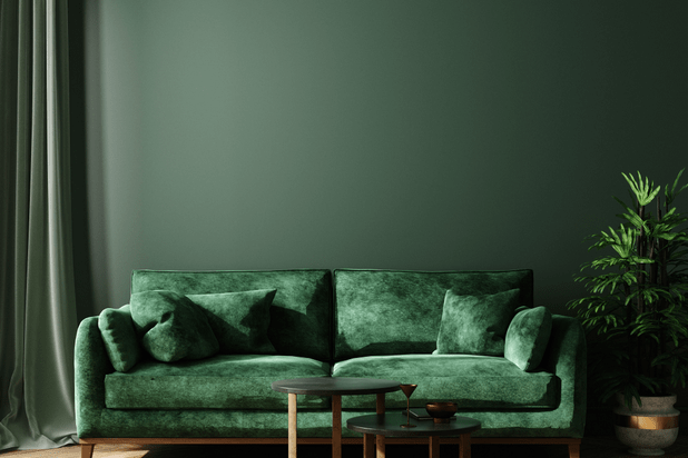 Home interior with green sofa, table and decor in living room