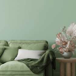minimal furniture with wooden home accessories on green background